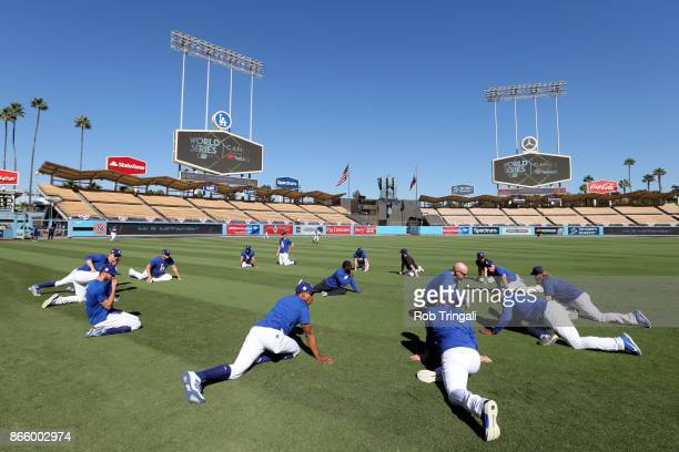 Members of the Los Angeles Dodgers stretch in the outfield prior to Game 1 of the 2017 World Series against the Houston Astros at Dodger Stadium on...