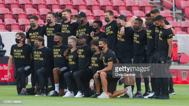 Members of the Los Angeles FC pose for a photograph on the field after their game against Real Salt Lake was postponed at Rio Tinto Stadium on August...