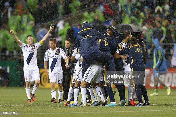 Members of the Los Angeles Galaxy celebrate after defeating the Seattle Sounders 21 winning the aggregate playoff 42 during Leg 2 of the Western...