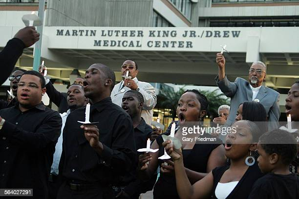 Members of the Los Angeles Inner City Mass Choir sing during the candlelight portion of a candlelight prayer vigil in front of Martin Luther King Jr...