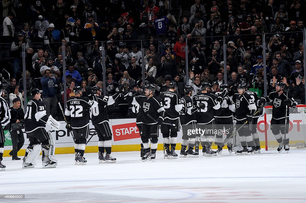 Members of the Los Angeles Kings celebrate a victory over the St. Louis Blues at STAPLES Center on December 18, 2014 in Los Angeles, California.