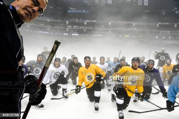 TOPSHOT Members of the Los Angeles Kings listen to their coach during an ice hockey practice session for the 2017 NHL China Games in Shanghai on...