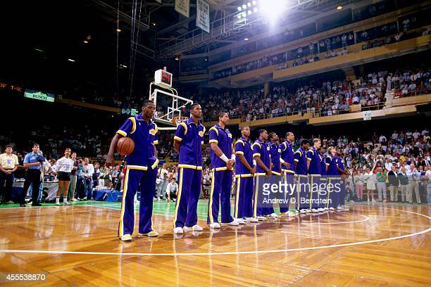 Members of the Los Angeles Lakers stand for 'The StarSpangled Banner' before Game Four of the 1987 NBA Finals against the Boston Celtics on June 9...