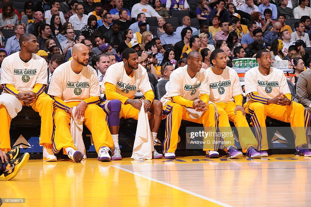 Members of the Los Angeles Lakers team cheer on from the bench against the New Orleans Hornets at Staples Center on April 9, 2013 in Los Angeles, California.