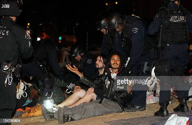 Members of the Los Angeles Police Department arrest protesters during the eviction of the Occupy LA tent encampment outside City Hall in the early...