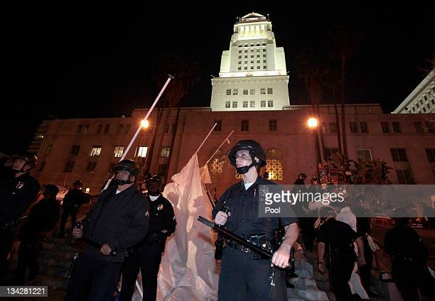 Members of the Los Angeles Police Department stand guard after starting the eviction of the Occupy LA tent encampment outside City Hall in the early...