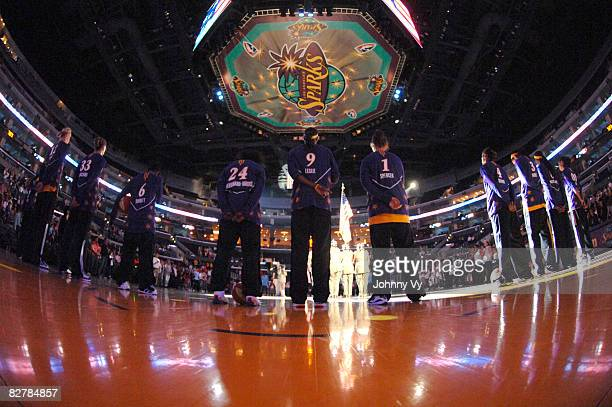 Members of the Los Angeles Sparks stand together during the National Anthem before a game against the Atlanta Dream on September 11 2008 at Staples...