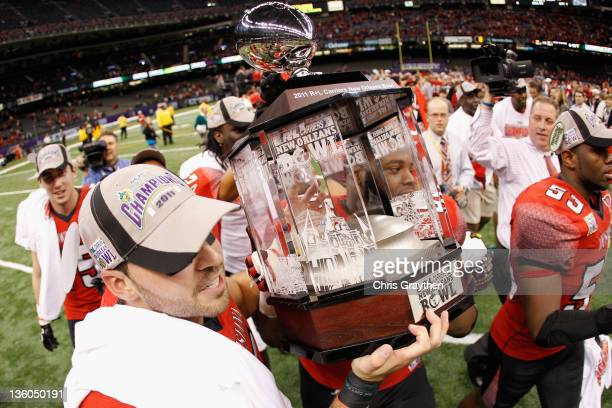 Members of the Louisiana-Lafayette Ragin Cajuns celebrate after defeating the San Diego State Aztecs 32-30 during the R&L Carriers New Orleans Bowl...