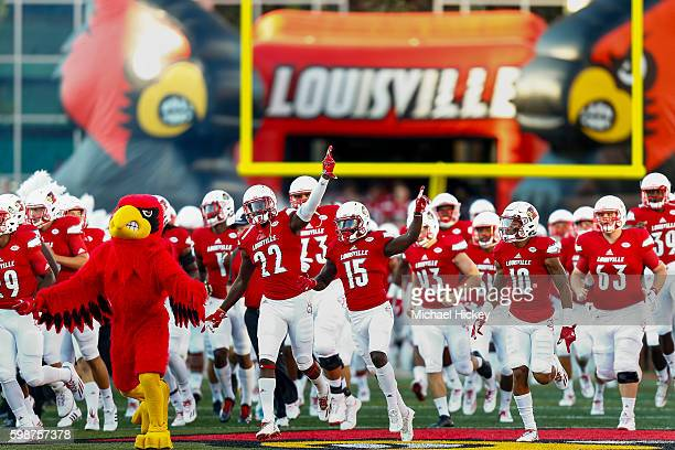 Members of the Louisville Cardinals take the field before the game against the Charlotte 49ers at Papa John's Cardinal Stadium on September 1 2016 in...