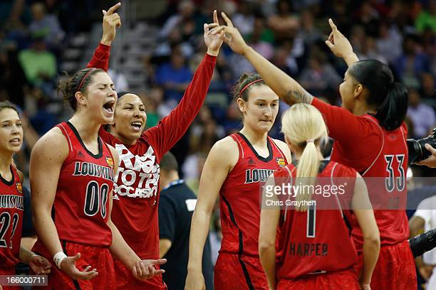 Members of the Louisville Cardnials celebrate after defeating the California Golden Bears 6457 to advance to the final roundduring the National...