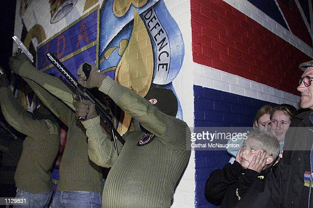 Members of the Loyalist paramilitary group the Ulster Freedom Fighters take part in a show of strength on Shankill Road July 11 2002 in Belfast...