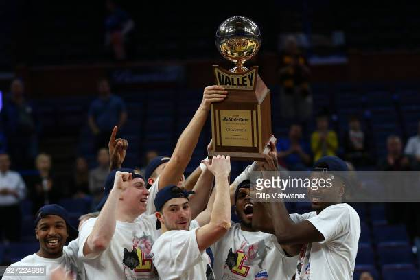 Members of the Loyola Ramblers hold the Missouri Valley Conference Champions trophy after beating the Illinois State Redbirds during the Missouri...