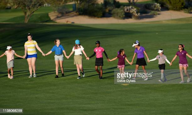 Members of the LPGAUSGA Girls Golf of Phoenix follow the final pairing up the 18th fairway during the final round of the Bank Of Hope Founders Cup at...