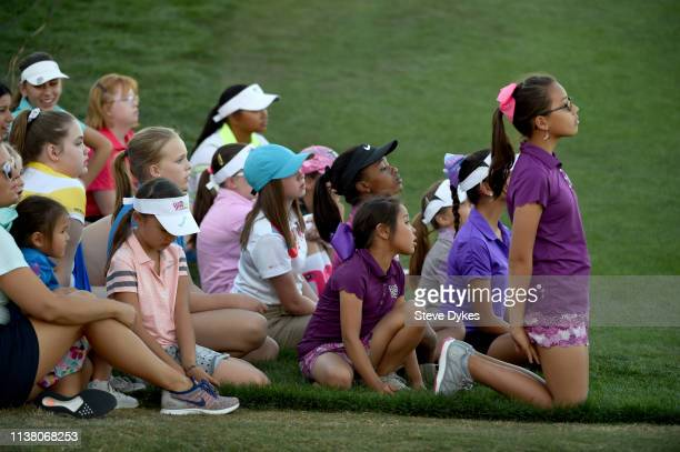 Members of the LPGAUSGA Girls Golf of Phoenix watch the action on the 18th green during the final pairing up the 18th fairway during the final round...