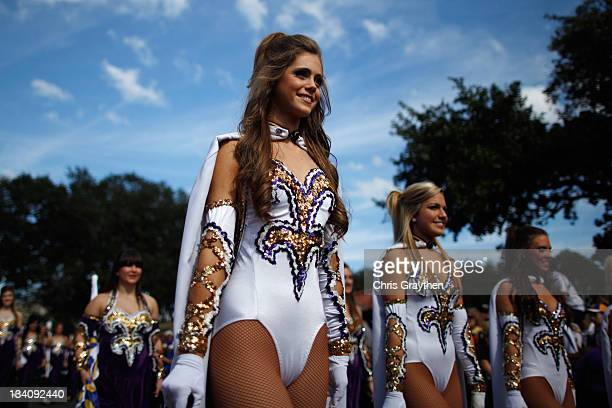 Members of the LSU Golden Girls march to the stadium before the LSU Tigers play the Arkansas Razorbacks at Tiger Stadium on November 25 2011 in Baton...