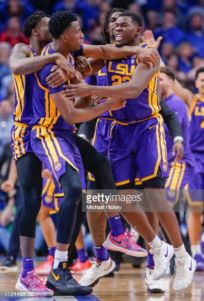 Members of the LSU Tigers celebrate with Kavell BigbyWilliams of the LSU Tigers after making the game winning tipin against the Kentucky Wildcats at...
