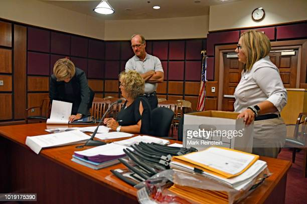 Members of the Lyon County Kansas, Board of Canvassers look over ballets presented to them by Lyon County Clerk Tammy Vopat and Lyon County Deputy...