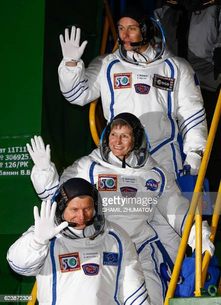 Members of the main crew of the 50/51 expedition to the International Space Station France's astronaut Thomas Pesquet Russia's cosmonaut Oleg...