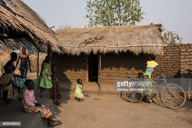 Members of the Majawa family and their neighbours get ready for church at their family home in the village of Masale which lies in one of the areas...