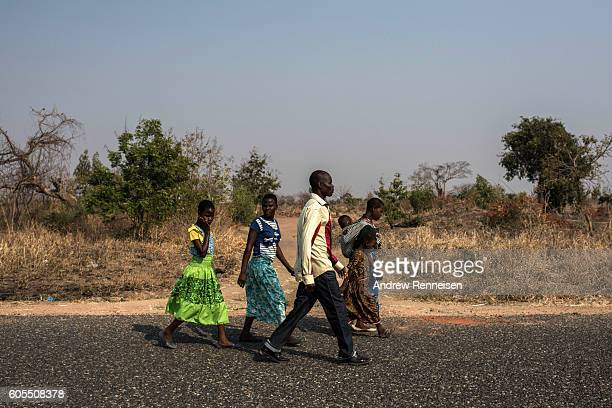 Members of the Majawa family walk to their church in the village of Mulele which lies in one of the areas most affected by drought on September 11...