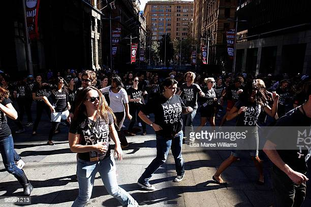 Members of the Make Poverty History campaign dance during a musical flash mob performance at Martin Place on May 11, 2010 in Sydney, Australia. The...