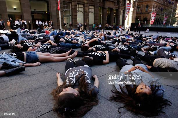 Members of the Make Poverty History campaign perform a musical flash mob at Martin Place on May 11, 2010 in Sydney, Australia. The performance aimed...