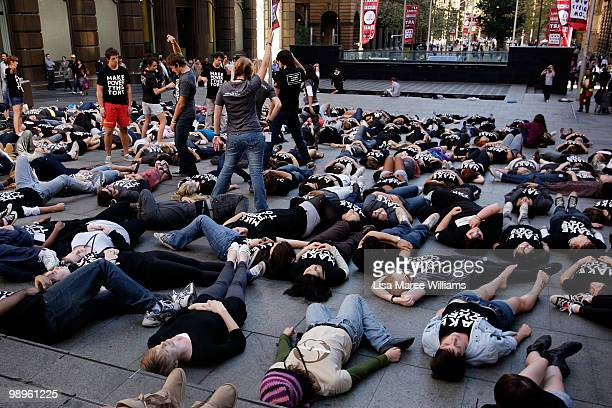 Members of the Make Poverty History campaign perform a musical flash mob at Martin Place on May 11 2010 in Sydney Australia The performance aimed to...