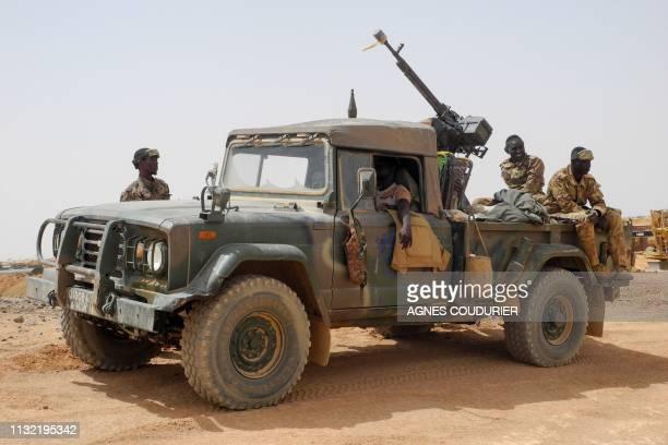 Members of the Malian Army patrol in Anderamboukane in Menaka region on March 22 2019
