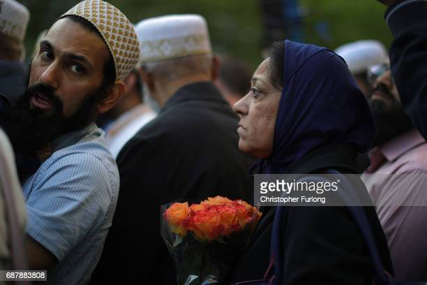Members of the Manchester Dawoodi Bohra Muslim Community pay their respects to victims of the Manchester attack in St Ann's Square on May 24 2017 in...
