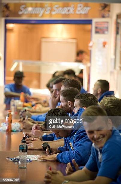 Members of the Mansfield Town firstteam squad signing autographs for fans in the Sandy Pate Lounge at Field Mill stadium during an open day held for...