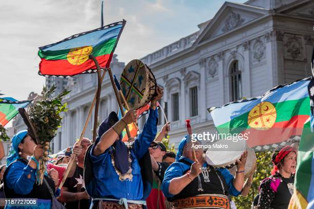 Members of the Mapuche community play a drum called kultrung as part of a ceremony at Plaza de Armas during a protest against president Sebastian...
