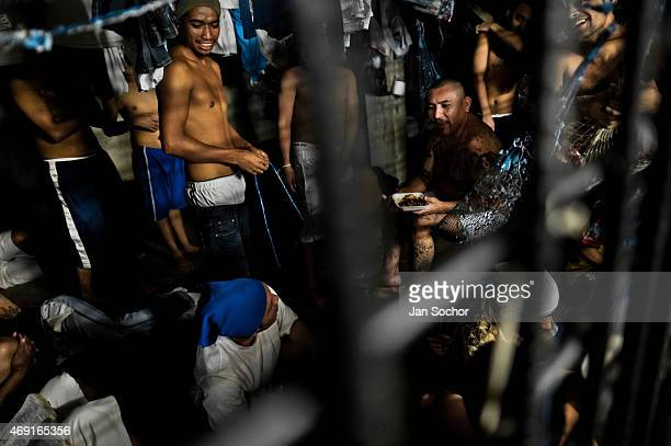 Members of the Mara Salvatrucha gang have lunch in an overcrowded cell at a detention center on February 20 2014 in San Salvador El Salvador Although...