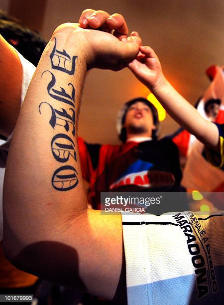 Members of the Maradonian Church The hand of God a religion dedicated to the Argentina's greatest ever soccer player Diego Maradona sing during their...