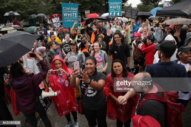 Members of The March to Confront White Supremacy gather for a brief rally behind the Martin Luther King Jr Memorial on September 6 2017 in Washington...