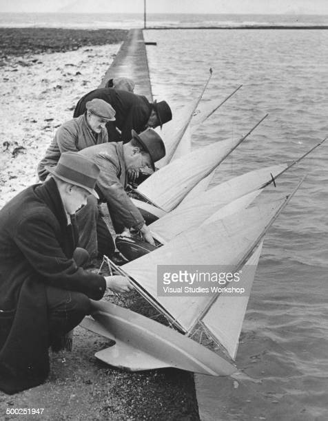 Members of the Margate Model Yacht Club make final adjustments to their model sailboats prior to the start of a sailing meeting at the boating pool...