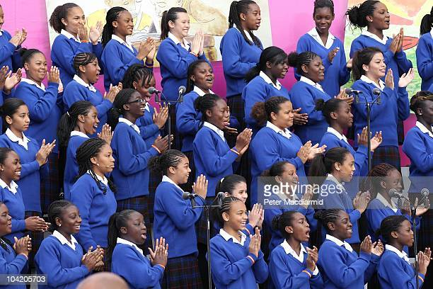 Members of the Maria Fidelis Roman Catholic School Gospel Choir applaud as Pope Benedict XVI arrives for The Big Assembly gathering at St Mary's...