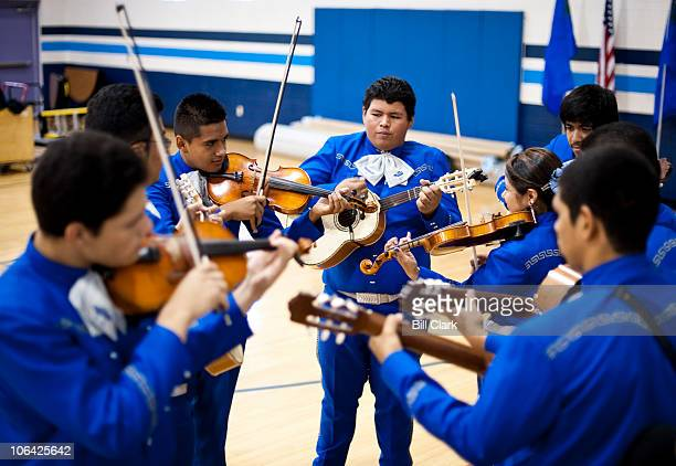 Members of the Mariachi Alma del Ca�on band from Canyon Springs High School warm up before playing for the crowd at Sen Harry Reid's Get Out The Vote...