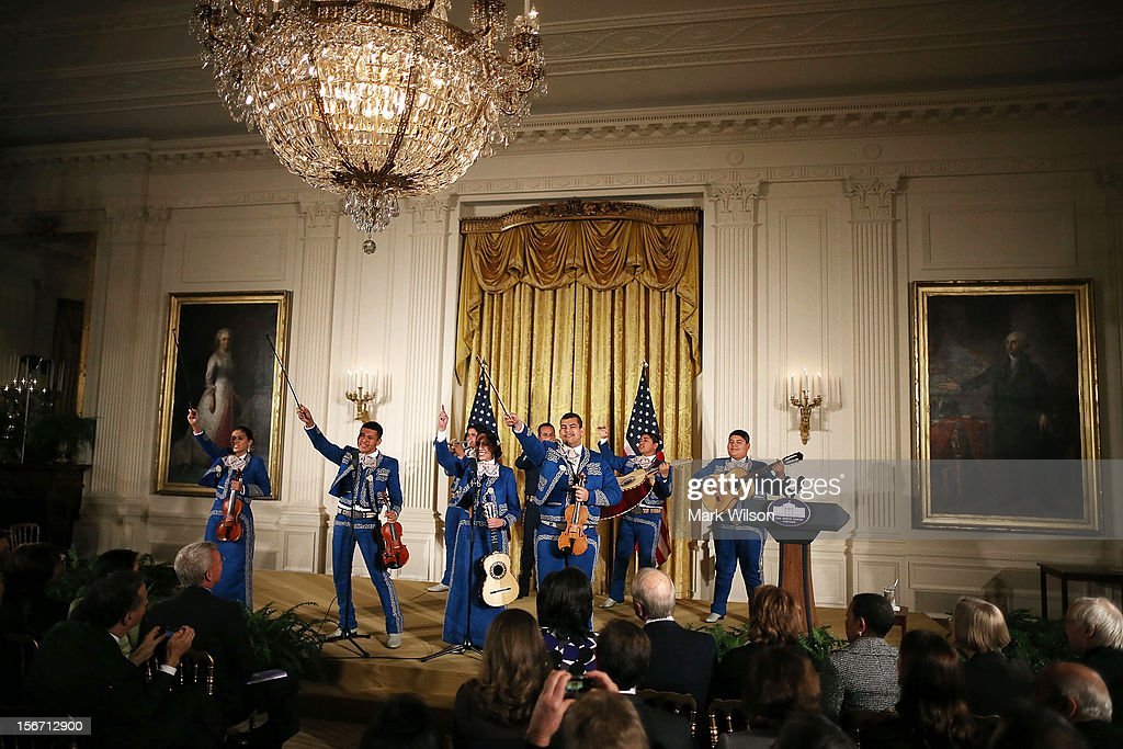 Members of the Mariachi Master Apprentice Program, from San Fernando, Ca., perform during an awards ceremony for the President's Committee on the Arts and the Humanities in the East Room at the White House on November 19, 2012 in Washington, DC. The first lady talked about the importance of afterschool and out of school arts and humanities education and presented awards recognizing programs across the country that benefit underserved youth.