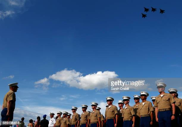 Members of the Marine Corp stand at attention prior to the start of the Monster Energy NASCAR Cup Series CocaCola 600 at Charlotte Motor Speedway on...