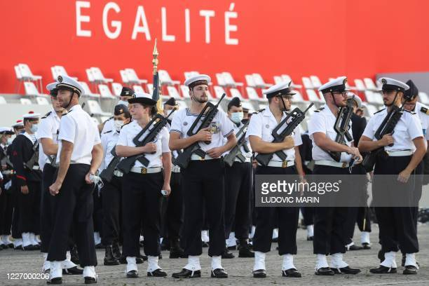 Members of the Marine Nationale arrive prior to the annual Bastille Day military ceremony on the Place de la Concorde in Paris on July 14 2020 France...