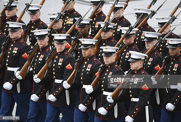 Members of the Marines march during the presidential inauguration at the US Capitol January 20 2017 in Washington DC Donald Trump was sworn in as the...