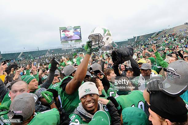 Members of the Marshall Thundering Herd and fans celebrate their 2623 defeat of the Louisiana Tech Bulldogs at Joan C Edwards Stadium during the...