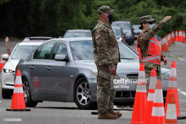 Members of the Maryland National Guard guide traffic at a coronavirus drivethru testing location at Six Flags America May 29 2020 in Bowie Maryland...