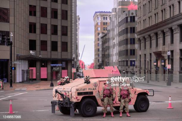 Members of the Massachusetts National Guard hold positions in front of the placard of the Boston Massacre in downtown Boston on June 7, 2020 in...