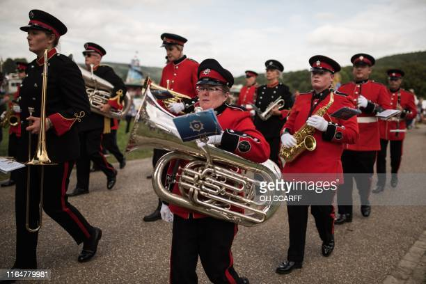 Members of the Massed Band of the Fire and Rescue Service perform on the first day of the Chatsworth Country Fair in the grounds of Chatsworth House,...