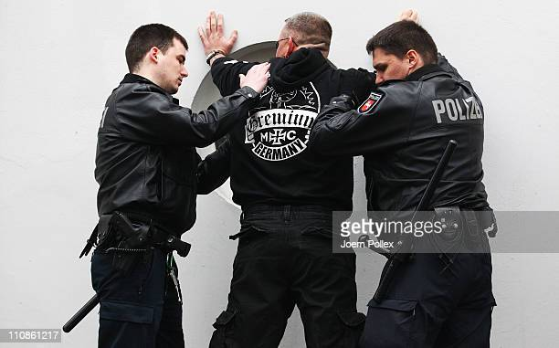Members of the MC Gremium motorcycle gang are checked by police in front of the court house on the first day of the trial for three members of the...