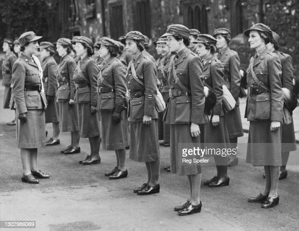 Members of the Mechanised Transport Corps stand at attention for Church Parade as they are inspected by their commanding officer on 30th June 1940 at...