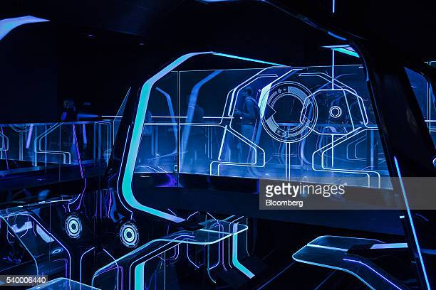 Members of the media and guests walk through the waiting area for the Tron Lightcyle Power Run rollercoaster at Walt Disney Co's Shanghai Disneyland...