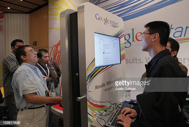 Members of the media and invited guests use the new Google Instant during a special launch event September 8 2010 in San Francisco California Google...