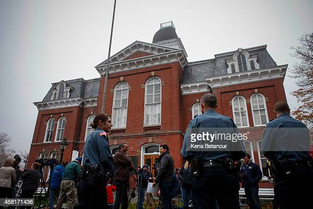 Members of the media and police officers stand in the front of the court house after Eric Frein makes first court appearance on October 31 2014 in...
